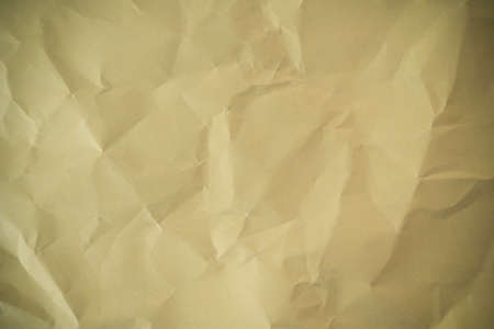 a sheet of crumpled colored paper as a background