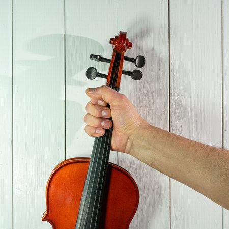 a violin on wooden table Standard-Bild