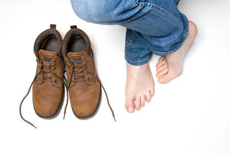 a man with bare feet Standard-Bild