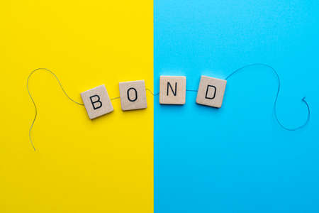 the word Bond formed with the letters linked together by a thread Standard-Bild - 163589277
