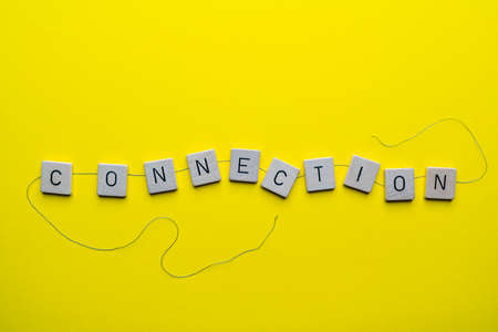 the word connection formed with the letters linked together by a thread Standard-Bild - 163589280