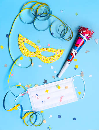 masks, confetti, treamers and mask on a colorful carnival