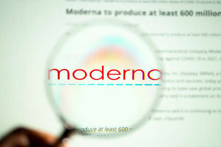 Udine, Italy. January 28, 2021. A look with the magnifying glass on the Moderna biopharmaceutical brand on the computer screen