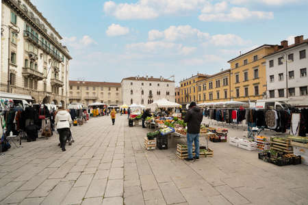 Udine, Italy. February 2 2021. the open-air market in piazza 20 settembre in the historic center of Udine Standard-Bild - 163757251