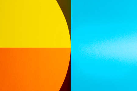 sheets of colored paper with a shadow formed on the surface Standard-Bild - 163334817