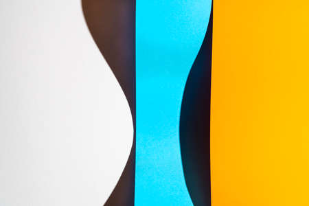 sheets of folded colored paper with a shadow formed on the surface Standard-Bild