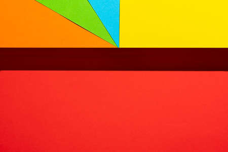 sheets of colored paper with a shadow formed on the red surface Standard-Bild - 163335702