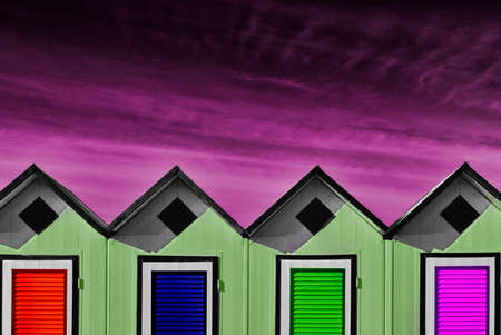 a row of beach huts with unlikely colors Standard-Bild
