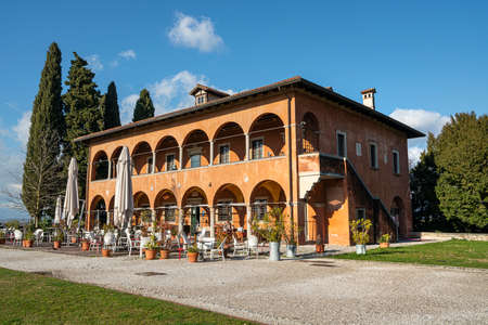 Udine, Italy. February 11, 2020. La Casa della Contadinanza (the house of peasant) on the castle hill in the city center Standard-Bild - 163757389