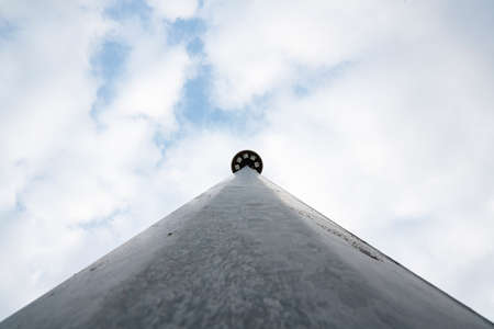 Bottom view of a large street light pole
