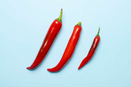 Some hot peppers on a colored surface
