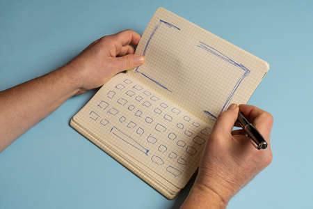 a notebook with the drawing of the keyboard and the screen of a notebook