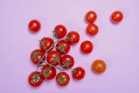 composition formed with some small Pachino tomatoes on a pink surface