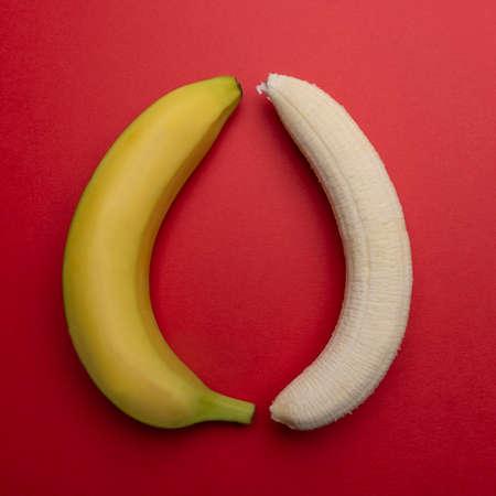 one peeled and one whole banana