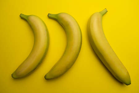 three bananas in a position opposite 스톡 콘텐츠