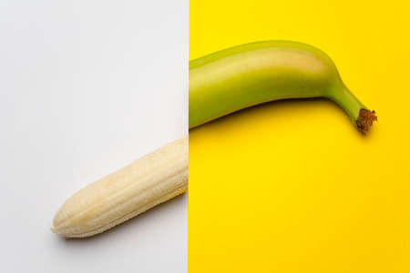 the banana cut in half on a colored surface