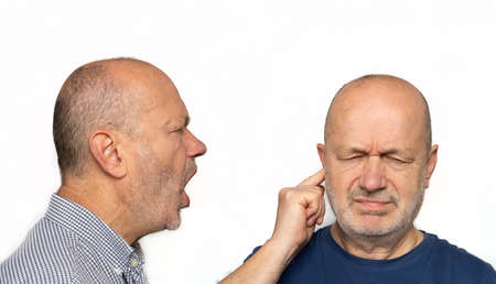 a man screaming in the ear. Concept of his ego screaming inside themselves