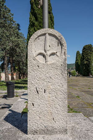 the symbol of the city carved on a stone capital in Trieste, Italy.