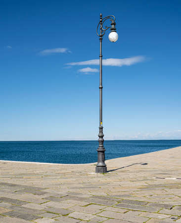 a street lamp on the waterfront in Trieste, Italy