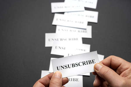 Some tickets with the word Unsubscribe arranged on the table, as a concept of the choice to cancel subscriptions