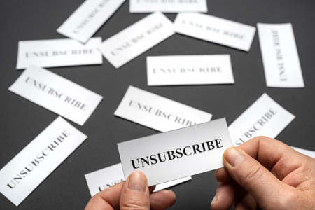Some tickets with the word Unsubscribe arranged on the table, as a concept of the choice to cancel subscriptions Stockfoto