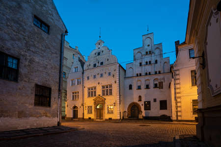 Riga, Latvia. August 2021. Evening exterior view of the famous ancient Three Brothers buildings in the city center Éditoriale