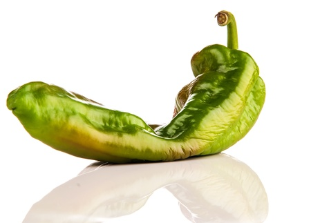 sluggish green pepper is photographed on a white background
