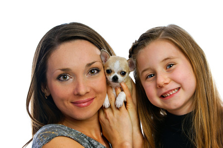 doggie: lovely beautiful girls with a doggie were photographed on a white background Stock Photo