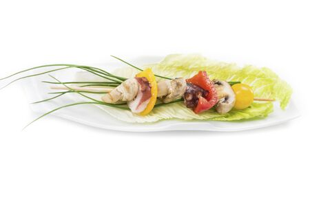 the shish kebab: the appetizing shish kebab from an octopus was photographed in studio Stock Photo