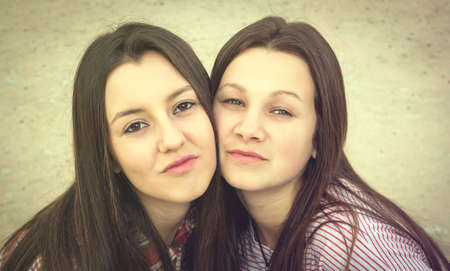 two girls: two girls were photographed  face to face