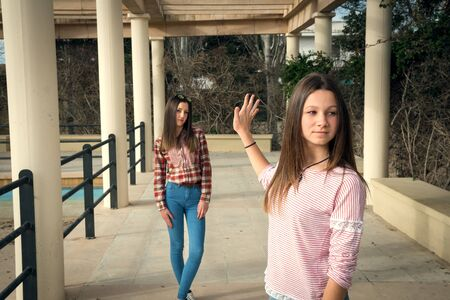 offended: two beautiful offended girls photographed in park on walk