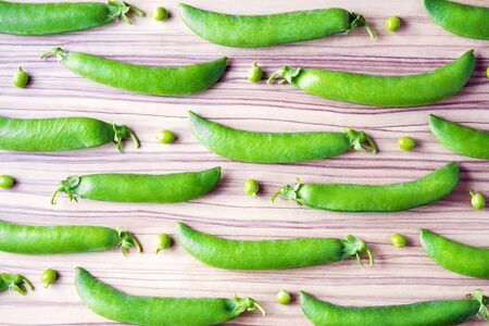 green been: ripe bright fresh green peas have been photographed in studio