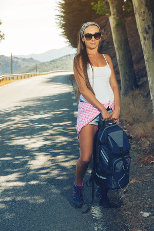 the beautiful girl the tourist has been photographed on walk on the mountains