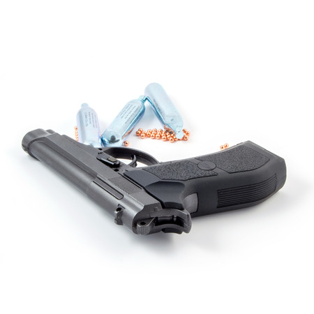 pellet gun: Black steel air pistol isolated on white. Gun, balloons and balls