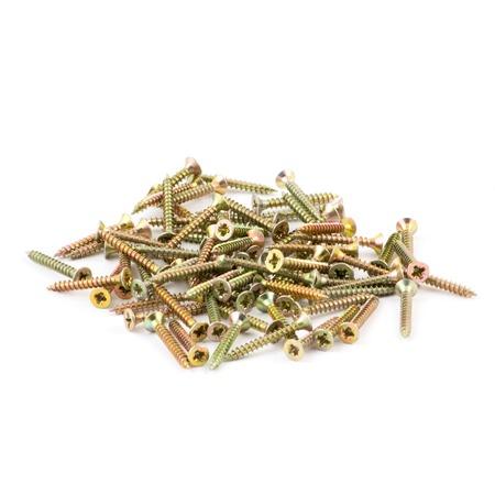 kinky: Golden screws isolated on white. Kinky nails Stock Photo