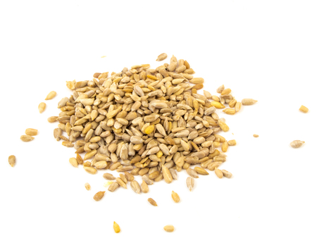 hulled: Sunflower seeds isolated on the white background. Stock Photo