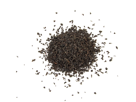 theine: dry black tea leaves isolated on white. Stock Photo