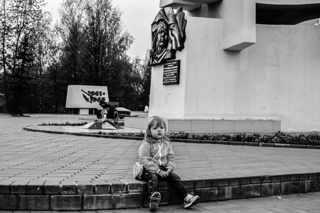 cossack parade: Girl at the monument to the liberators of the soldiers in the Victory Park in Kirov. May 9 Victory Day. Black and White.