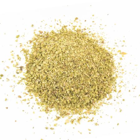 herbal background: Pile of dried oregano leaves on a white background.