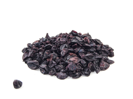 barberry: Dried aromatic barberry berries on white background. Stock Photo
