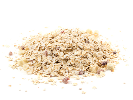 tinting: Heap of muesli with apple and cherry, isolated on white.  Delicious granola cereal mix, with dried fruit and seeds.