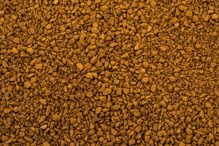 granules: Granules of instant aromatic brown coffee background.
