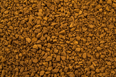 aromatic: Granules of instant aromatic brown coffee background.