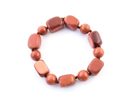 aventurine: mineral gem stone Aventurine - orange brown gemstone isolated on white background. Stock Photo