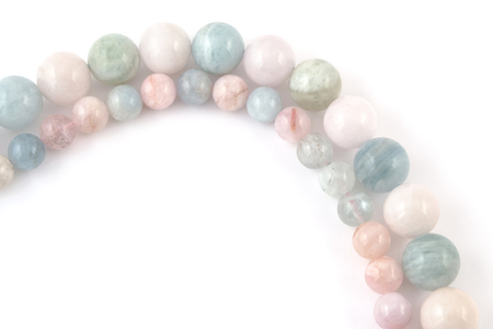 lapidary: beryl crystal mineral gem beads sample on white background.