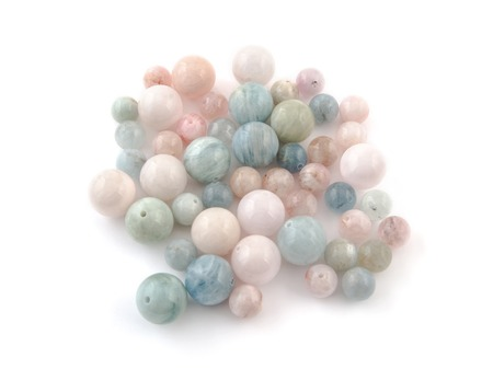 beryl crystal mineral gem beads sample on white background.
