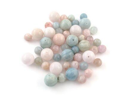 amethyst rough: beryl crystal mineral gem beads sample on white background.