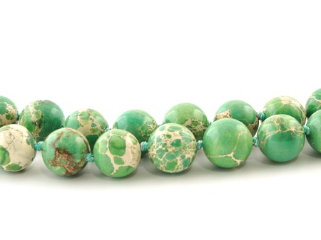 chatoyant: Natural mineral rock green Variscite gem stone isolated on white background. Stock Photo