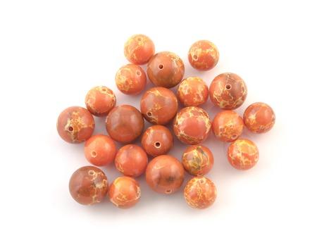 chatoyant: Natural mineral rock orange Variscite gem stone isolated on white background.