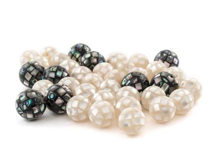 irridescent: Beautiful beads from Abalon Haliotis natural gemstone on white background.
